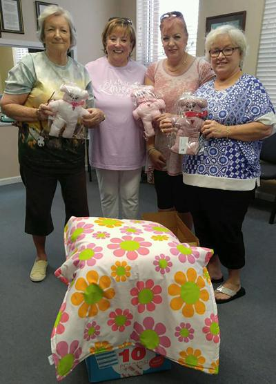 Local church group stitches blankets, bears for children
