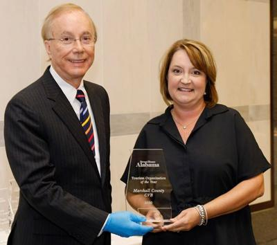 State Tourism Director Lee Sentell presents Katy Norton, president of the Marshall County CVB with Organization of the year award.jpg