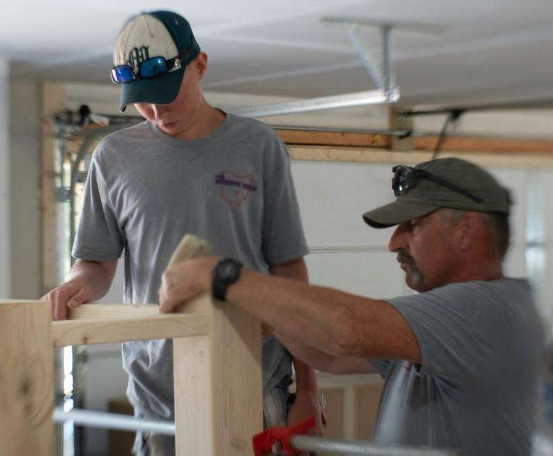Ryan Fitzpatrick, left, works with Albertville Firefighter Mark Hand