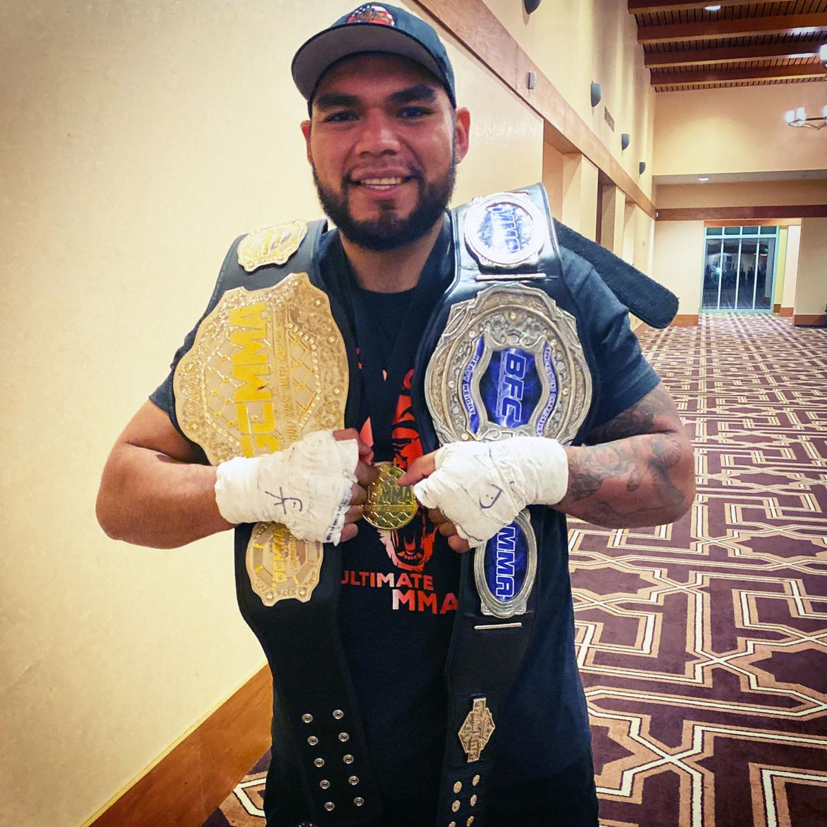 Jose Evans with belts.jpeg