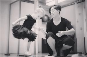 Dance Teacher Helping Young Girl.jpg