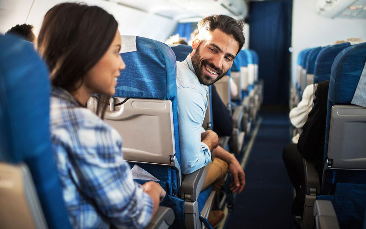 Passengers talking in airplane.