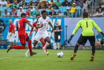Canada midfielder Alphonso Davies (12) looks for a shot on goal against Cuba on Sunday, June 23, 2019 during the CONCACAF Gold Cup soccer match at Bank of America Stadium in Charlotte, N.C.