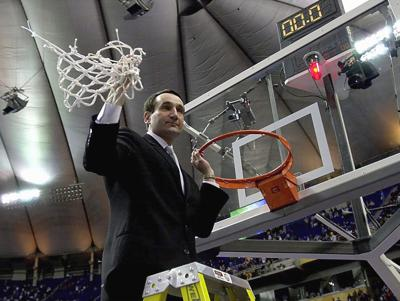 Duke head coach Mike Krzyzewski cuts down the net after the Blue Devils' 82-72 victory against Arizona to win the NCAA National Championship at the Metrodome in Minneapolis on April 2, 2001.