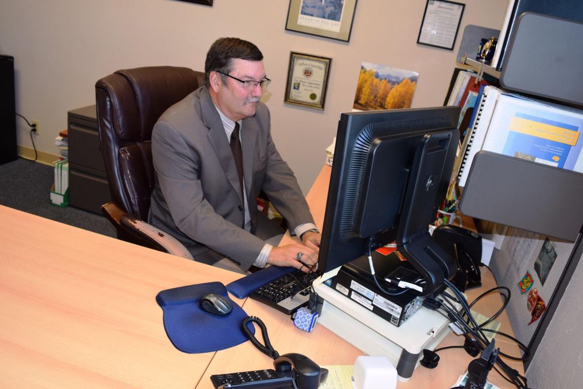 Larry Appel at desk