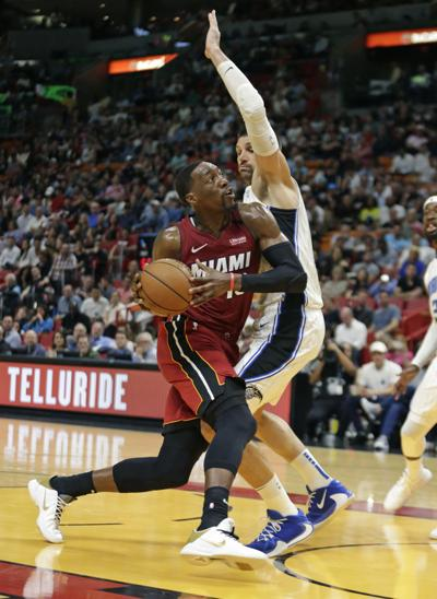 The Miami Heat's Bam Adebayo (13) drives against the Orlando Magic's Nikola Vucevic (9) in the second quarter at the AmericanAirlines Arena in Miami on Wednesday, March 4, 2020.