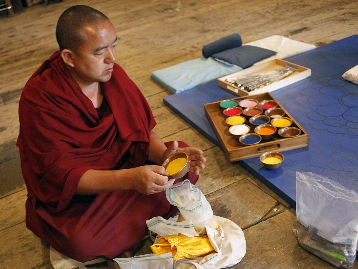 Tibetan monks creating sand mandalas on the Central Coast
