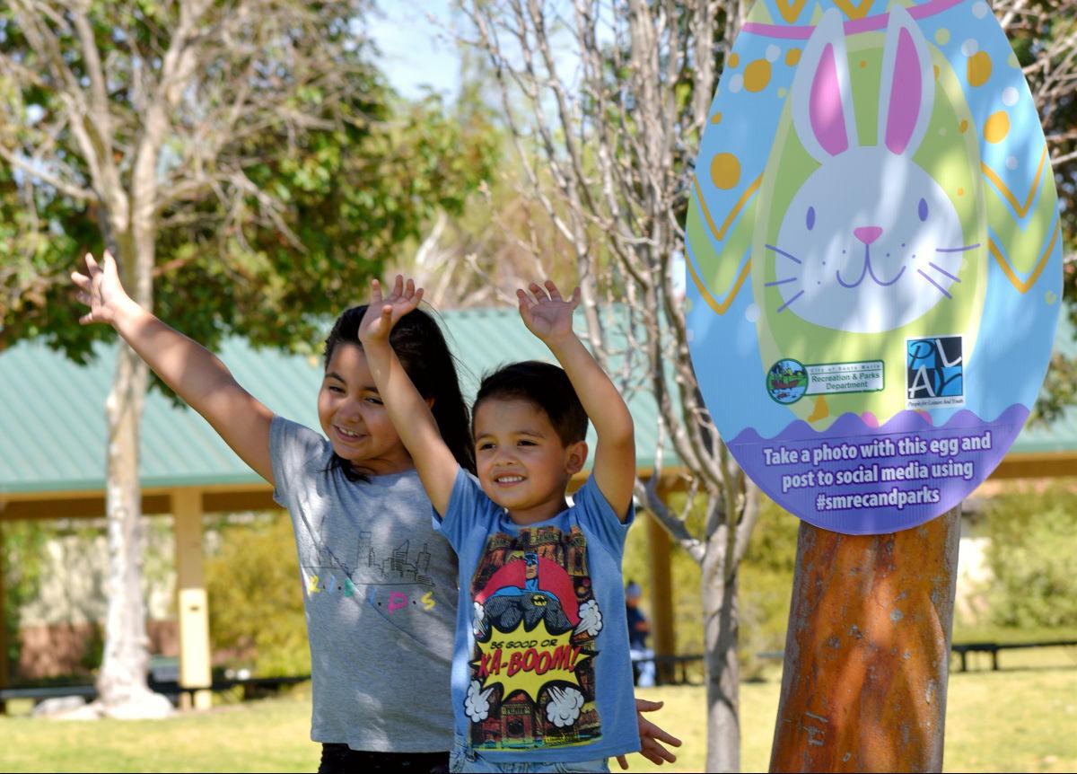 Marla and Roberto Ibarra celebrate by hidden Easter egg at Rotary Park in Santa Maria Friday.