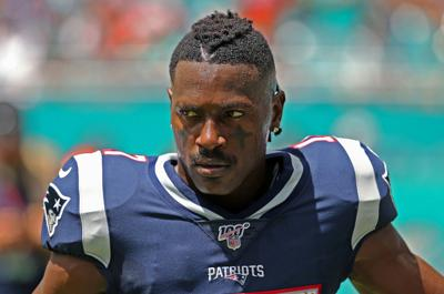 New England Patriots wide receiver Antonio Brown looks on before the start of a game against the Miami Dolphins at Hard Rock Stadium in Miami Gardens, Fla., on September 15, 2019.