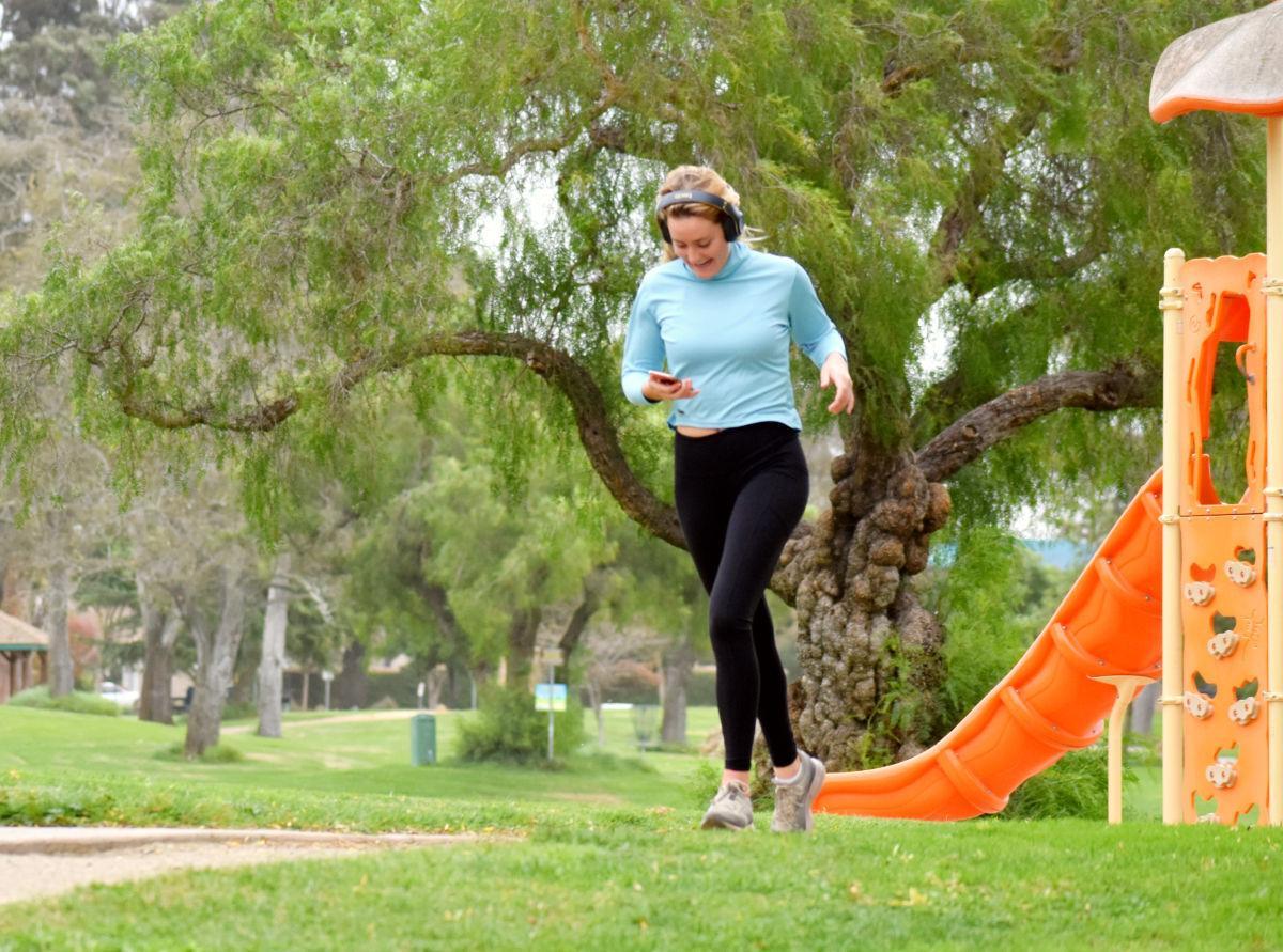 A local jogger takes the path through Preisker park Friday evening in Santa Maria.