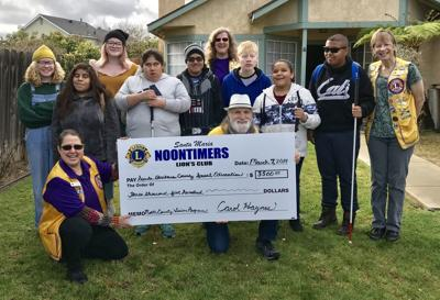 SM Noontimers Lions present check to Vision Program staff students