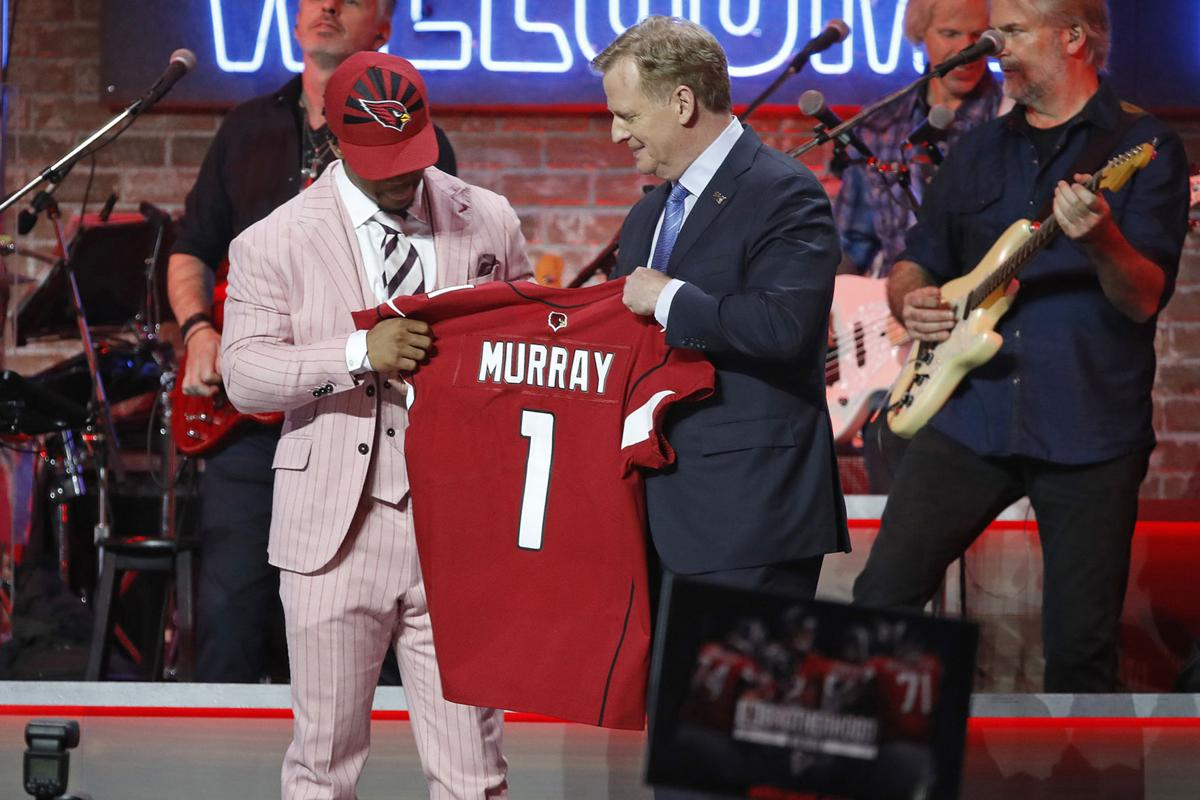 NFL commissioner Roger Goodell, middle, with Kyler Murray after the quarterback was drafted first overall by the Arizona Cardinals at the NFL Draft on April 25, 2019, in Nashville, Tenn.