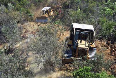 Bulldozers fire break