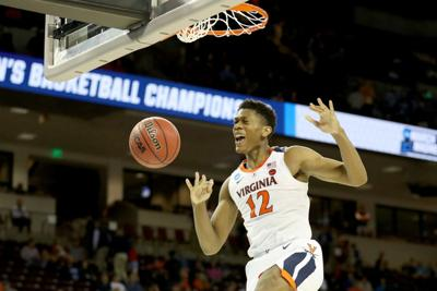 Virginia's De'Andre Hunter dunks against Oklahoma during the second half in the second round of the NCAA Tournament at Colonial Life Arena in Columbia, S.C., on March 24, 2019. (Streeter Lecka/Getty Images/TNS) *FOR USE WITH THIS STORY ONLY*