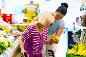 Helping elderly at grocery store.jpg