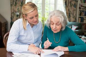 Women helping elderly with paperwork.jpg