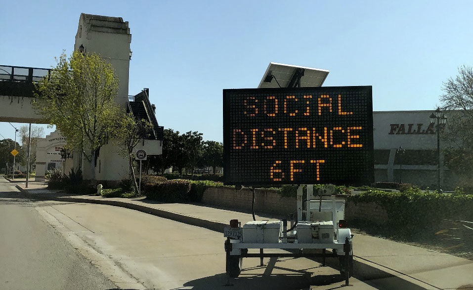Lighted social distancing sign