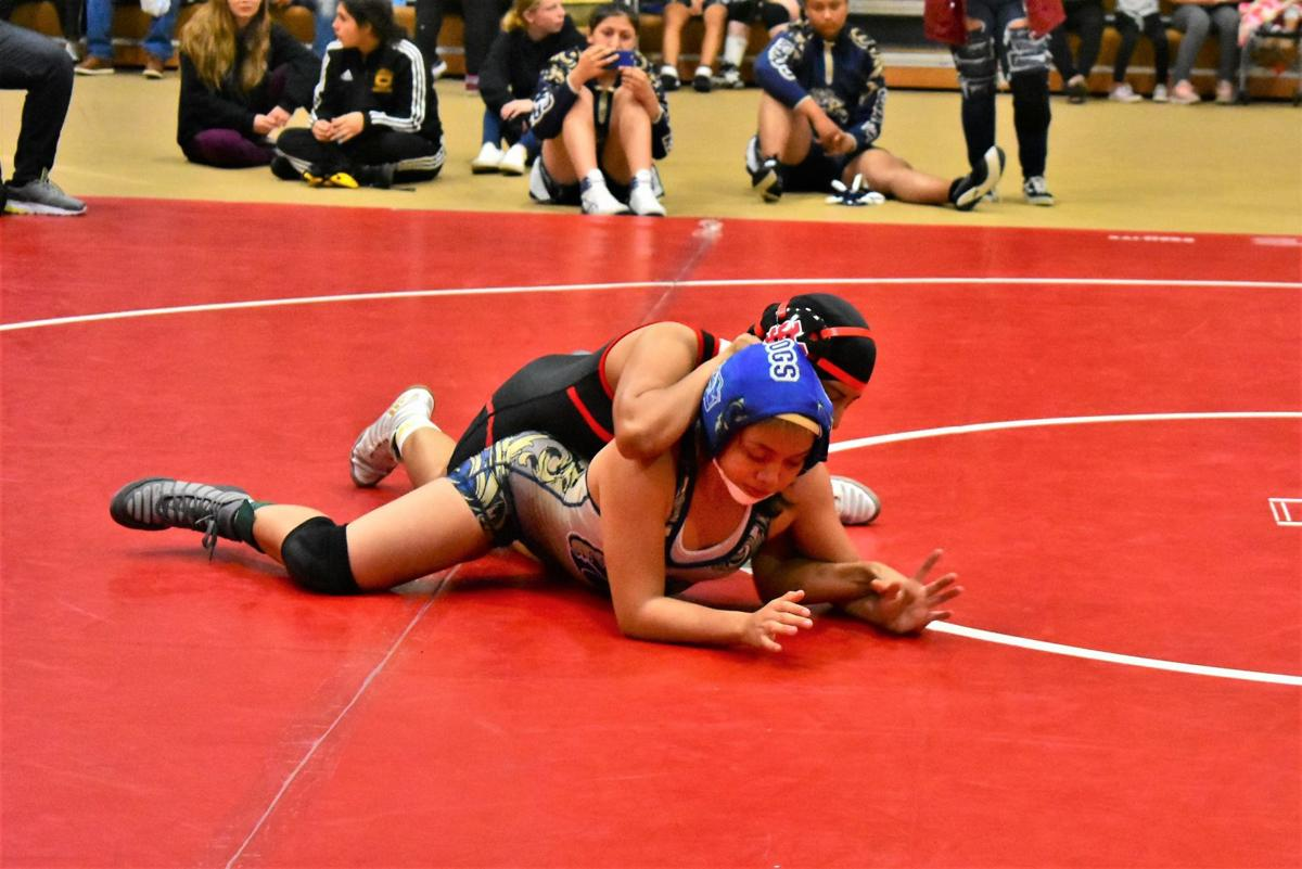 Santa Maria's Jennifer Hernandez trying to pin Golden Valley's Celeste Cubillo