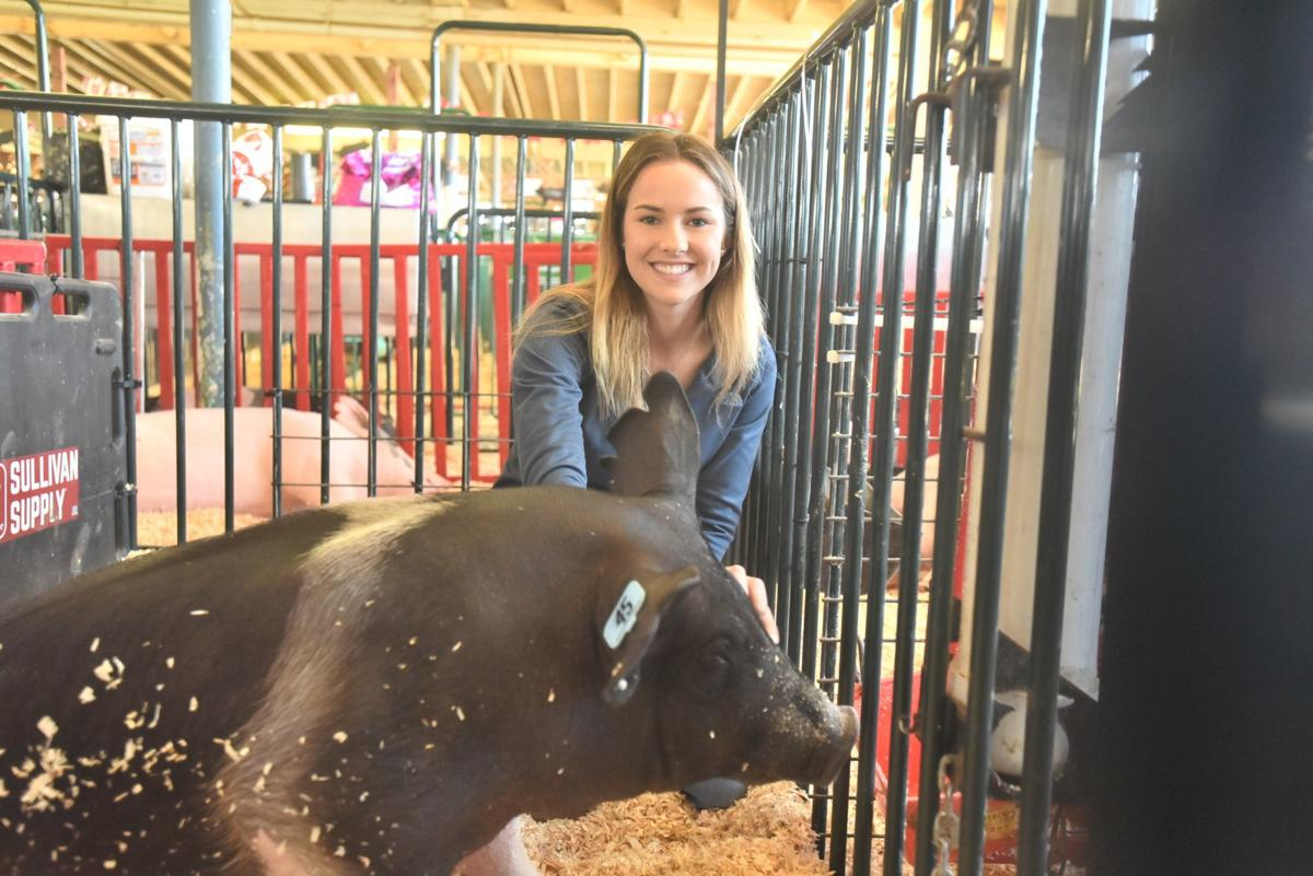 Jenna Moore with pig