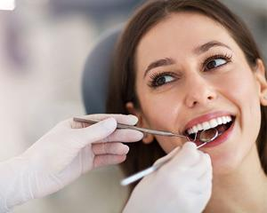 Woman having teeth examined at dentists.jpg
