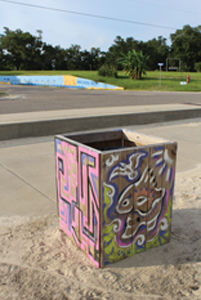 Bringing Art to the Beach: Members of The Arts, Hancock County contribute to Trash Barrel Community Art project