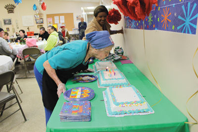 Necia blows out the candles