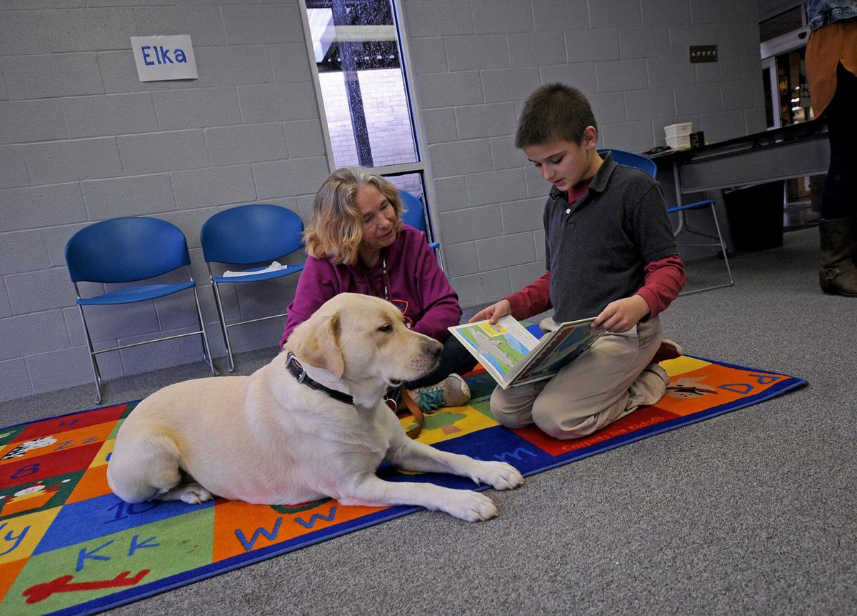 Area children practice reading to therapy dogs