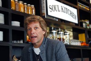 <p>In this Oct. 19, 2011, file photo, rock star Jon Bon Jovi sits in his JBJ Soul Kitchen community restaurant in Red Bank, N.J. The restaurant is providing free meals to local government workers and their families during the federal government shutdown. JBJ Soul Kitchen in Red Bank announced on Facebook it will provide the free meals to furloughed workers Monday, Jan. 21, 2019, between 12 p.m. and 2 p.m. (AP Photo/Wayne Parry, File)</p>