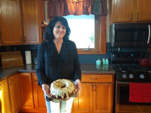 <p>Shelly Simon with her Old-Fashioned Apple Cake.</p>