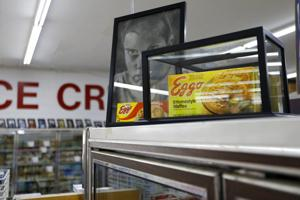<p>In this Monday, July 22, 2019 photo, a box of Eggo Homestyle Waffles used as a prop in Netflix's Stranger Things sits atop a refrigerator in Piggly Wiggly grocery store in Palmetto, Ga. Stranger Things filmed scenes for seasons one and three at Piggly Wiggly, formerly known as Bradley's Big Buy, including a scene in which a character steals boxes of waffles. (AP Photo/Andrea Smith)</p>
