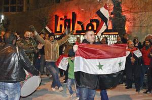 """<p>In this photo released by the Syrian official news agency SANA, Syrians celebrate as they hold their national flags in Aleppo province, Syria, Monday, Feb. 17, 2020. On Monday Syria's military announced its troops have regained control of territories in northwestern Syria """"in record time,"""" vowing to continue to chase armed groups """"wherever they are.""""</p>"""