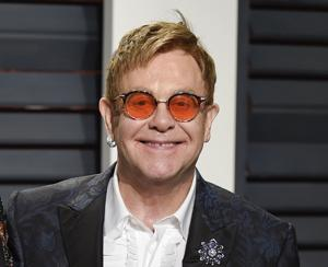 <p>FILE. In this Feb. 27, 2017 file photo, Elton John arrives at the Vanity Fair Oscar Party in Beverly Hills, Calif.</p>