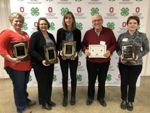 <p>Among those recognized by Wood County 4-H on Thursday were Robin Belleville (from left), Kim Davis, Sara Foos, 5th H Award honoree Dick Martin and Volunteer Spirit honoree Joely Giammarco.</p>