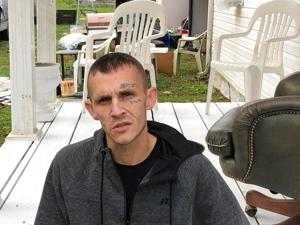<p>In this Oct. 30, 2019 photo, Joshua Bessey discusses what happened to him in September at the Gallia County Jail in southern Ohio, during an interview in Vinton, Ohio. Bessey says a sheriff's deputy pushed him over while he was strapped in a restraint chair, causing serious injuries that led to him being flown to a Columbus hospital where he was in a coma for four days. (AP Photo/Mark Gillispie)</p>