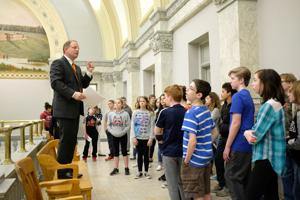 <p>File. Wood County Common Pleas Court Judge Matthew Reger talks to students inside the Wood County Courthouse.</p>