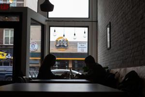 <p>Customers sit in the dark at Flatlands Coffee in Bowling Green Thursday afternoon. </p>
