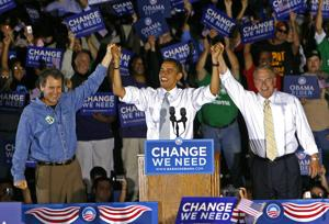 <p>FILE - In this Oct. 9, 2008, file photo, Democratic presidential candidate Sen. Barack Obama, D-Ill., middle, is introduced by Sen. Sherrod Brown, D-Ohio., left, and Ohio Gov. Ted Strickland, right, during a rally at Shawnee State University, in Portsmouth, Ohio. As Democrats bring their primary debate to Ohio Tuesday, the question is whether the Republican foothold in Appalachia and places like industrial Youngstown is irreversible, whether Ohio is a political battleground no more.</p>