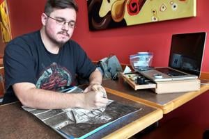 Disability doesn't hold back artist's pen