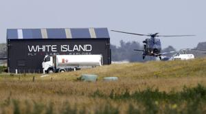 <p>A Navy helicopter returns to Whakatane Airport following the recovery operation to return the victims of the Dec. 9 volcano eruption continues off the coast of Whakatane New Zealand, Friday, Dec. 13, 2019. A team of eight New Zealand military specialists landed on White Island early Friday to retrieve the bodies of victims after the Dec. 9 eruption.</p>