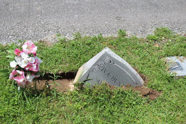 Displaced headstones at Snuffer Cemetery appear to be caused by automobile