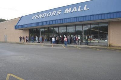 Booth-owners pull merchandise out from Vendors Mall