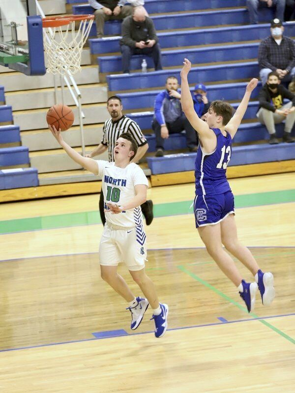 TAKING CARE OF BUSINESS:<span>North Laurel knocks off No. 2 ranked Cov. Cath behind Sizemore's game-winning 3-pointer, Sheppard's 45 points</span>