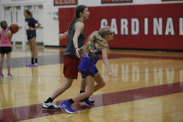 Fine tuningthe skills at basketball camp