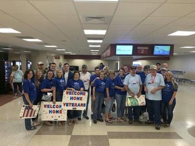 Flag-waving crowd packs Blue Grass Airport and welcomes veterans home from Honor Flight