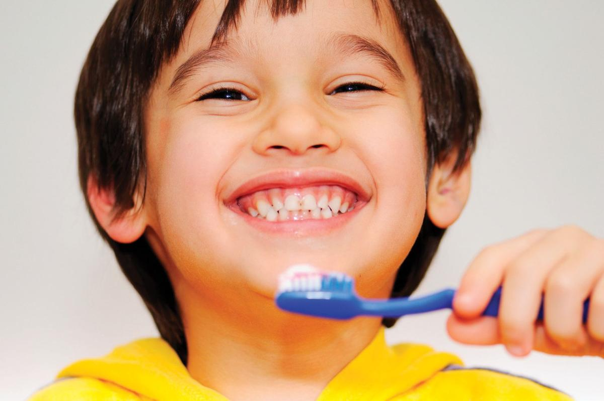 Image result for child brushing teeth