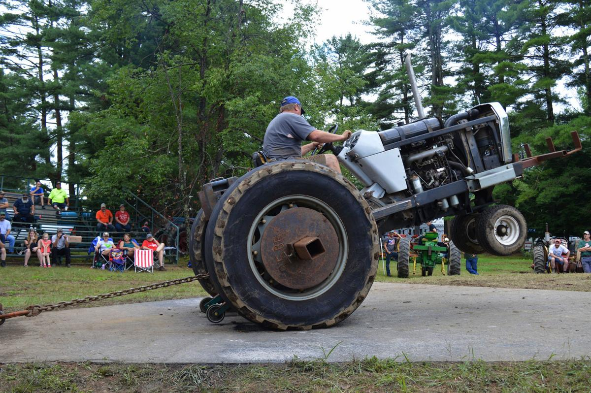 Tractor pull competitors push through the rain at Cheshire