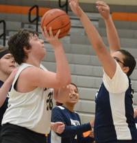 Whole team chips in as Keene unified basketball team tops Nashua North for first win