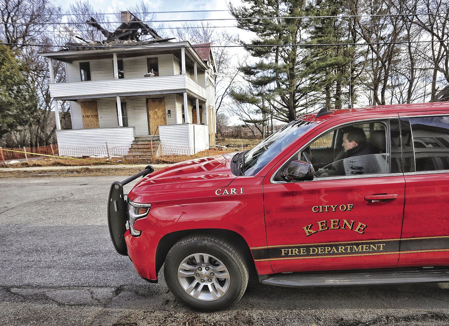 Keene Fire Chief Mark F. Howard Waits For A Crew To Come And Expand The  Protective Zone Around The Burned Out Shell Of The House At 169 Church St.  In April ...