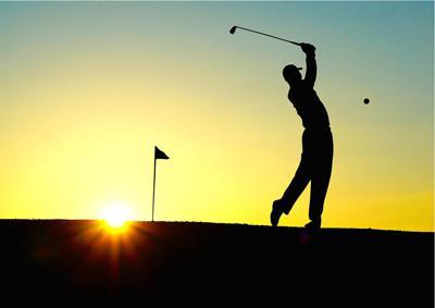 man-playing-golf-sunset