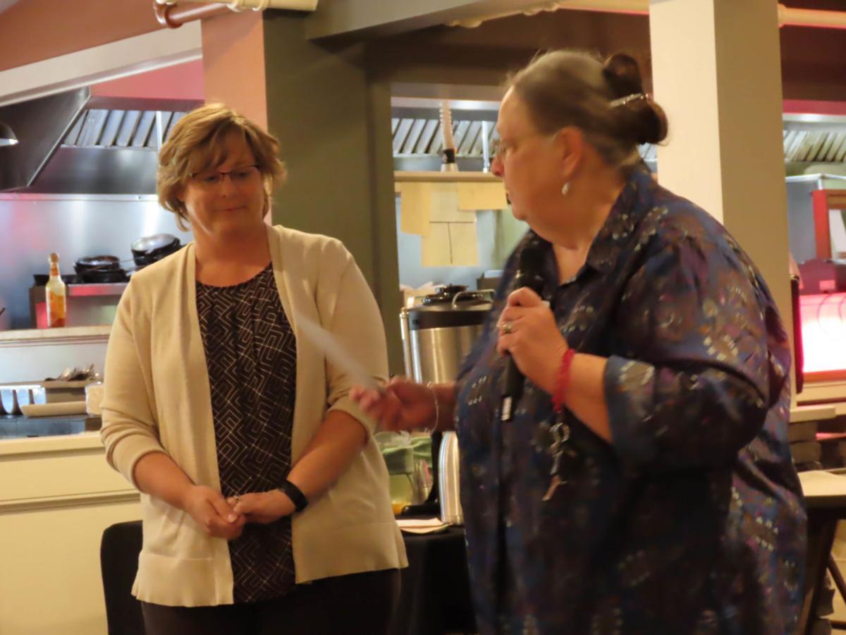 20210806-MAG-j-r rotary Gail give Patty Farmer a check (2)